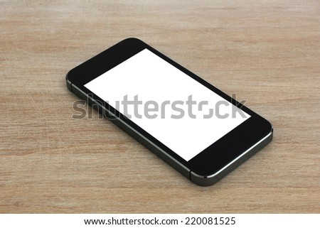 Smart phone with blank screen lying on wooden table, iphon style - stock photo