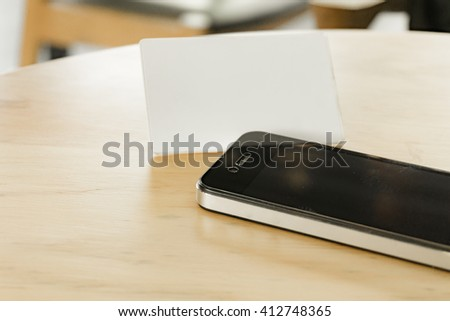 smart phone with business card background - stock photo