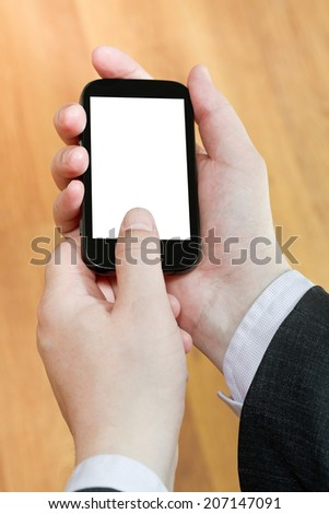 smart phone with cut out screen in businessman hands close up - stock photo