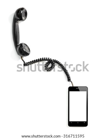 Smart phone with old fashioned style telephone handset receiver. - stock photo