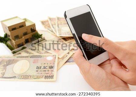 Smart phone with paper money - stock photo