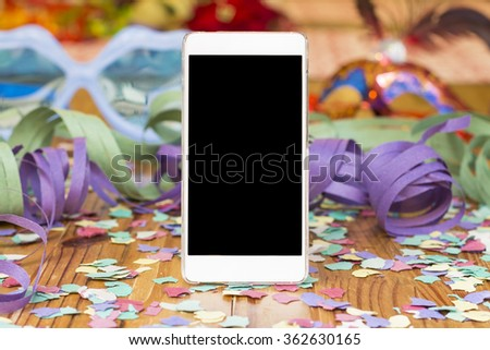Smart phone with party, carnival background - stock photo