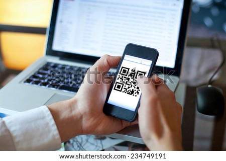 smart phone with qr code on the screen - stock photo