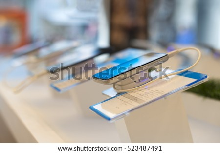 Smart phones in store. Telecommunication shop. Showcase with phones