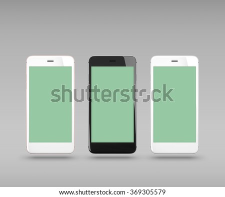 Smart phones isolated on gray background. With clipping paths for their displays. - stock photo
