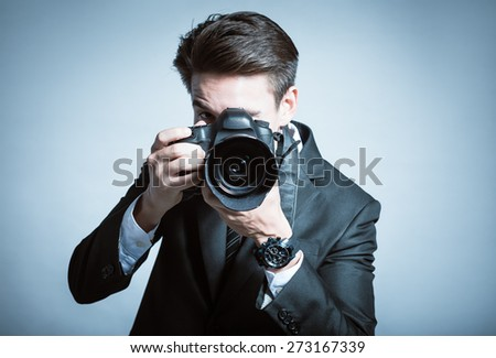 Smart photographer in suit.  - stock photo