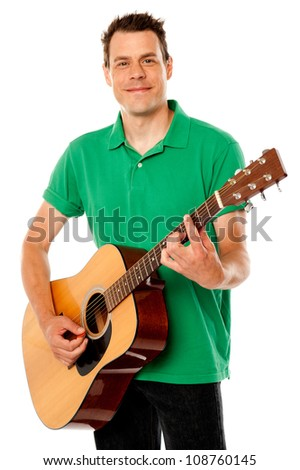 Smart rock guitar player at his best. Playing guitar against white background - stock photo