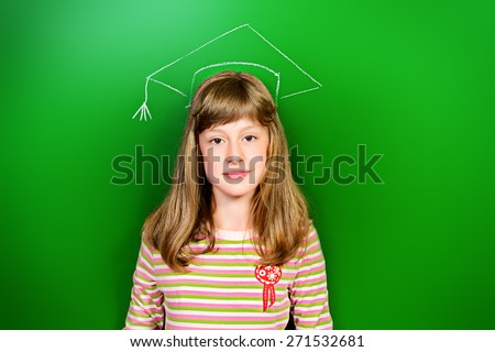 Smart schoolgirl stands at the blackboard in the classroom. Educational concept. New idea. - stock photo