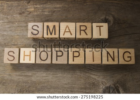 Smart shopping text on a wooden background - stock photo