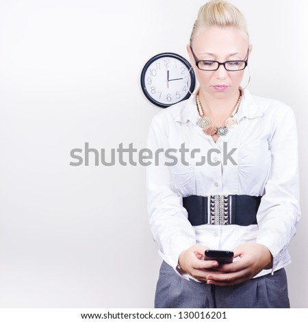 Smart stylish business person sending a mobile phone text message during lunch break