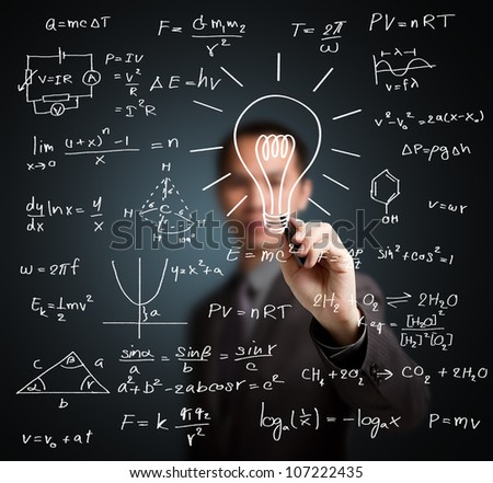 smart teacher writing various high school maths and science formula with light bulb ( symbol of idea and solution )