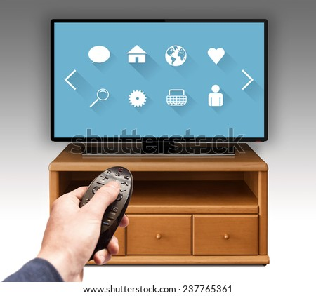 Smart tv UHD 4K controled by hand using remote control. - stock photo