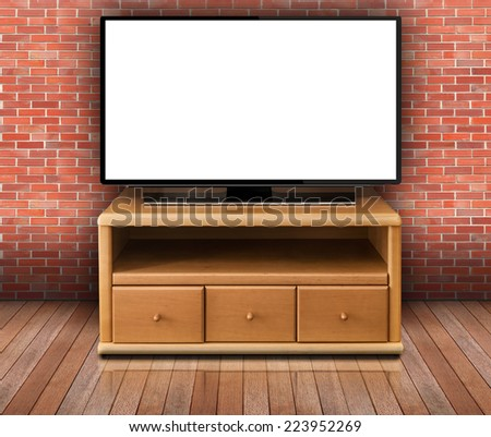 smart tv with blank screen in modern living room with bricks wall and wooden floor - stock photo