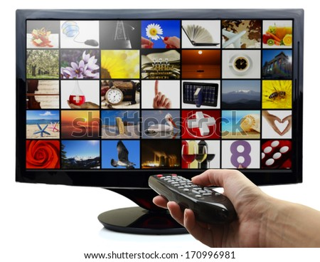 Smart tv with photos and hand holding remote control - stock photo