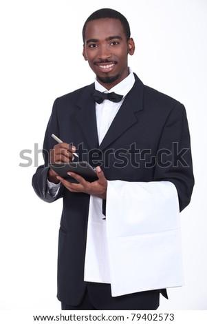 Smart waiter taking order - stock photo