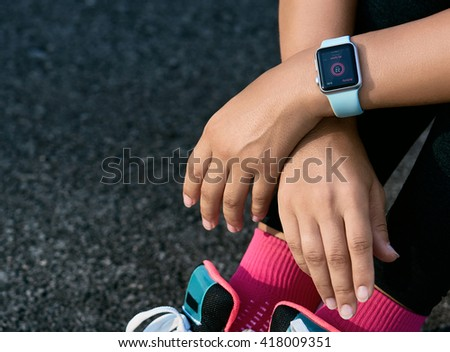 Smart watch on a sporting girl wrist. Smart watch health, heart rate and fat burn monitoring. Jogging goals preparation. Bright everyday sport concept mock up. Lifestyle concept.