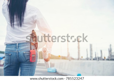 Smart woman engineer holding white safety stock photo 785523247 smart woman engineer holding white safety hard hat helmet for security equipment and blueprint paper working malvernweather Image collections