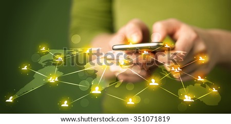 Smart woman holding telephone with world social media network connection - stock photo