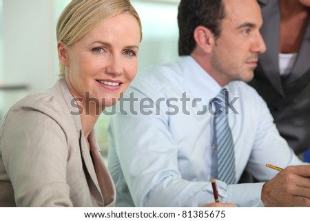 Smart woman in a meeting - stock photo