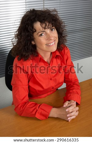 Smart woman sitting in a  chair