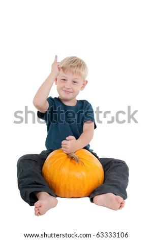 Smart young boy explaining how one can grow a big pumpkin - stock photo