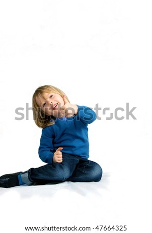 Smart young boy showing thumbs up sign, isolated with lot of free copyspace - stock photo