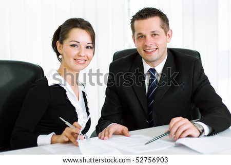 Smart young business people smiling and working in the office