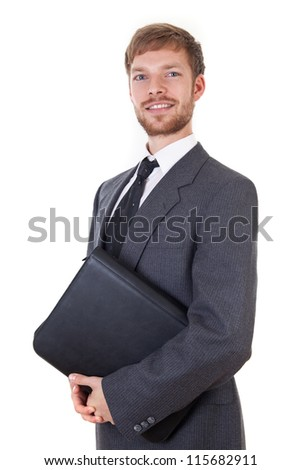 Smart young businessman with leather map - stock photo