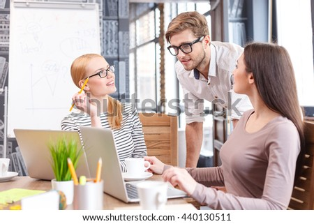 Smart young colleagues discussing new project - stock photo