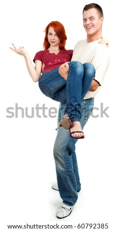 smart young man carrying cute girlfriend in his arms - stock photo