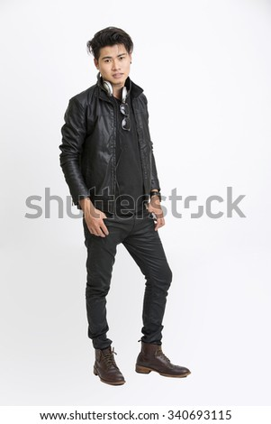 Smart young man posing in urban style with headphone on white. - stock photo