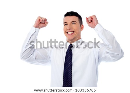 Smart young man raising his hands in excitement - stock photo