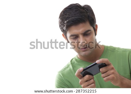 Smart young man using mobile phone over white background