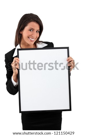 Smart young woman holding a blank board ready for your text - stock photo