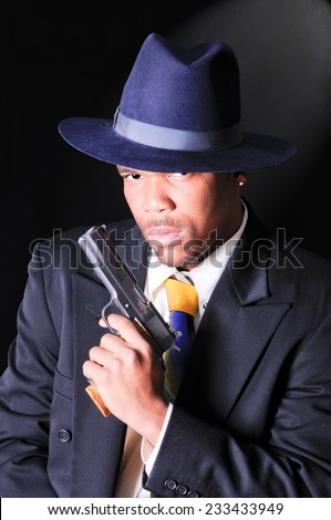 smartly dressed African American man, either a retro gangster or FBI agent theme - stock photo