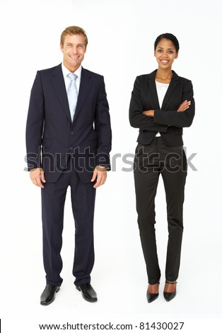 Smartly dressed businessman and woman - stock photo