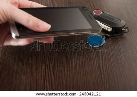 Smartphone and NFC tag, NFC (Near Field Communication) theme - stock photo