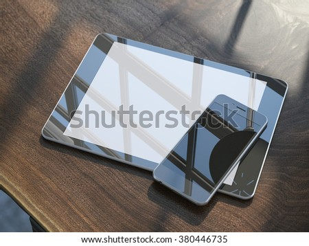 Smartphone and tablet on the wooden table - stock photo