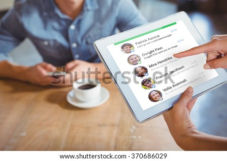 Smartphone app menu against person using tablet computer in cafe - stock photo