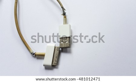 Smartphone charging cable is lacerated on white background isolated.