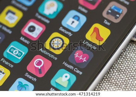 Smartphone home screen, various application icons in the focus.