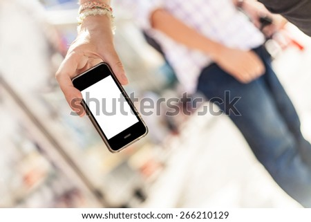 smartphone in a hand on the street - stock photo