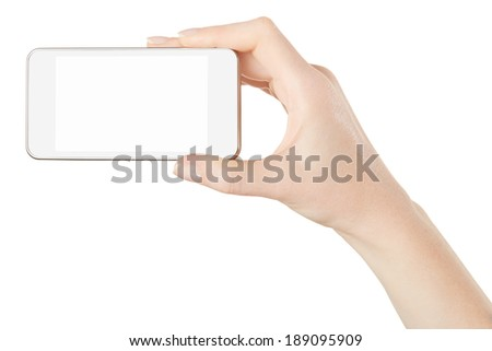 Smartphone in female hand on white, clipping path included - stock photo