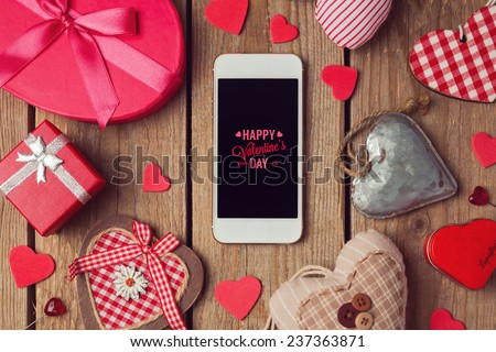 Smartphone mock up template for Valentine's day with heart shapes - stock photo