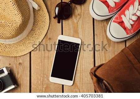 Smartphone mock up template with hipster fashion objects. View from above. Flat lay