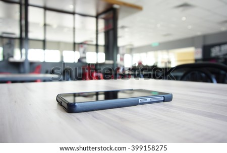smartphone on a table - stock photo