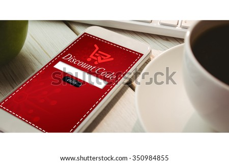 Smartphone on desk against sale advertisement