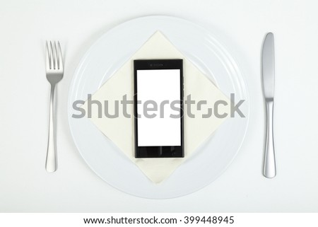Smartphone on plate - stock photo