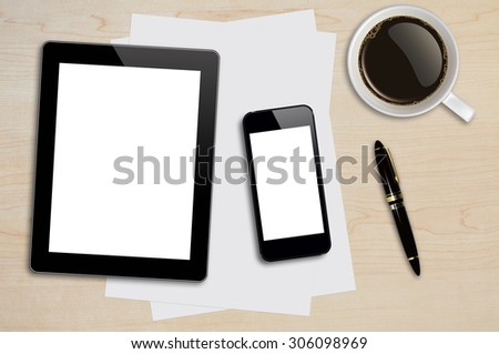 Smartphone, tablet, coffee cup, pen and page on wood background with copy space and text space - stock photo