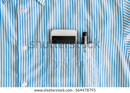 Smartphone with a black screen and pen in a pocket of shirt - stock photo
